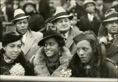Thumbnail of Jesse and Ruth Owens sitting with an unknown group of people, circa 1930s
