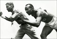 Thumbnail of Jesse Owens and Coach Larry Snyder posed in a running position, circa 1936