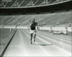 Thumbnail of Jesse Owens stretching the tape at Ohio Stadium, 1935