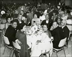 Thumbnail of Jesse and Ruth Owens at a dinner event, circa 1960s