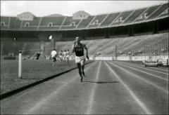 Thumbnail of Jesse Owens crossing the finish line during a practice run, 1935