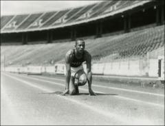 Thumbnail of Jesse Owens crouched in the starting postion, 1935