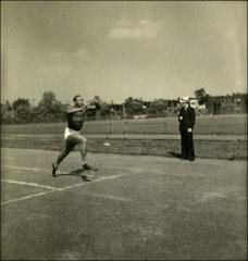 Thumbnail of Jesse Owens crossing the finish line with his arms up, with an unidentified man, 1935