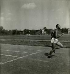 Thumbnail of Jesse Owens finishing his practice run, 1935