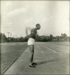 Thumbnail of Jesse Owens swinging his arms, side view, (unclear photo), 1935