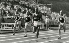 Thumbnail of Jesse Owens, moments before he crosses finish line in the 220 yard dash, Ohio Stadium, 1936