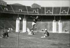 Thumbnail of Jesse Owens competing in the long jump at Ohio Stadium, 1936