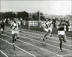 Thumbnail of Jesse Owens crossing the finish line at the Big Ten Track and Field Championships, 1935