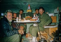 Thumbnail of Frank Layman (left to right), Bert Crary, Walter Boyd, Hugh Bennett, and Ed Robinson celebrate Christmas inside a sno-cat