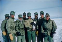 Thumbnail of Navy men pose with a penguin