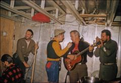 Thumbnail of Bill Cumbie (guitar), pianist Richard Chappell (lower left) and other members of the unofficial Little America band strike it up