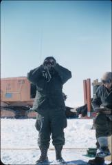 Thumbnail of Bert Crary (standing) and Dr. Trevor Hatherton map an area of the Ross Ice Shelf