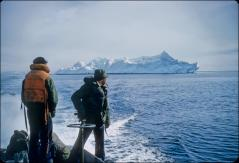 Thumbnail of Navy men check an iceberg in the Ross Sea