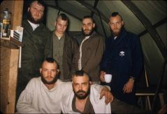 Thumbnail of Navy seabees show their Mohawk haircuts at Little America. Charles Dater (standing right) and Steven Munz (seated right)