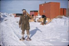 Thumbnail of Bert Crary snow shoeing with survey equipment