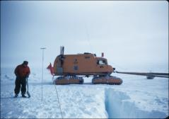 Thumbnail of Walter Boyd checks ground near sno-cat halted by crevasse