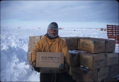 Thumbnail of William J. Cromie unloads explosives for seismic work