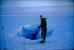 Thumbnail of William J. Cromie checks Ross Ice Shelf crevasse on skis