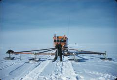 Thumbnail of William J. Cromie in front of crevasse detector on sno-cat