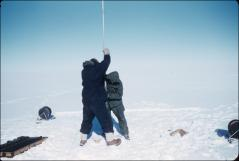 Thumbnail of Traverse team drilling into ice (drillers unknown)