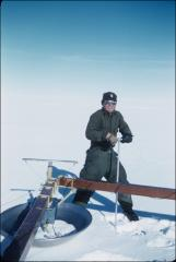 Thumbnail of William J. Cromie testing ice strength in front of crevasse detector