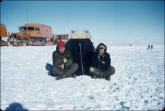 Thumbnail of Visitors from LOOK magazine, writer Tom Morgan (right) and photographer John Vacon, pose in front of their tent