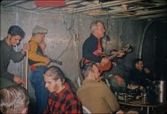 Thumbnail of Guitarist Bill Cumbie, Boy Scout Richard Chappell on piano (red plaid shirt), and others put together a band