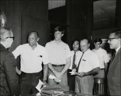Thumbnail of Jesse Owens meets with a group of administrative officials and athletes, 1960s