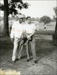 Thumbnail of Jesse Owens poses with a man at a golf outing, 1960s