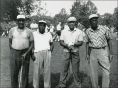 Thumbnail of Jesse Owens in a group at a golf outing, 1960s