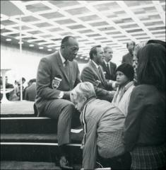 Thumbnail of Jesse Owens meets young fans at a sports panel discussion, 1960s