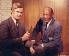 Thumbnail of Jesse Owens poses for a photo with an interviewer at the Lincoln-Mercury Sports Panel, 1960s