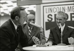 Thumbnail of Arnold Palmer and Jesse Owens sit at a table during the Lincoln Mercury Sports Panel, 1960s