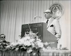 Thumbnail of Jesse Owens giving a speech at the National Association of Collegiate Directors of Athletics program, 1960s