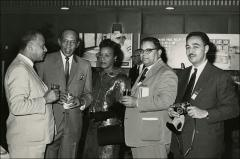 Thumbnail of Jesse and Ruth Owens speaks with others at a Seiko event in Japan, 1964