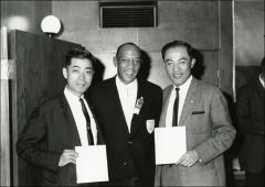 Thumbnail of Jesse Owens poses with two unknown men during his trip to Japan, 1964