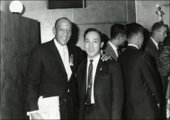 Thumbnail of Jesse Owens poses with an unknown man during his trip to Japan, 1964
