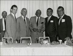 Thumbnail of Jesse Owens poses with members of the National Association of Collegiate Directors of Athletics, 1960s