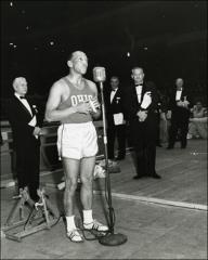 Thumbnail of Jesse Owens gives a speech at the New York Athletic Club Indoor Games, 1964