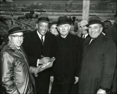 Thumbnail of Jesse Owens signs a program in a group shot with the Mayor of Pittsburgh, 1968