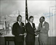Thumbnail of Jesse Owens presents two awards at a ceremony, 1960s