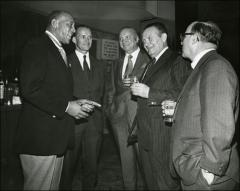 Thumbnail of Jesse Owens in a group at a bar, 1960s