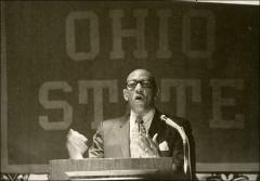Thumbnail of Jesse Owens speaks behind a podium in Dayton for an OSU event, 1971