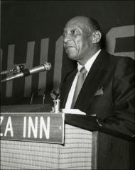 Thumbnail of Jesse Owens gives a speech on stage for an OSU event, 1970s