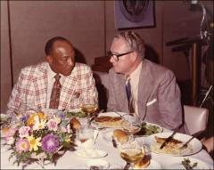 "Thumbnail of Jesse Owens talks during dinner at the ""Great Olympic Moments"", 1972"