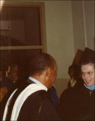Thumbnail of Jesse Owens mingling in a back room before the OSU Autumn Commencement, 1972
