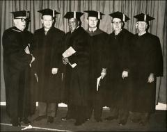 Thumbnail of Jesse Owens poses with OSU academics and administrators at the Autumn Commencement Ceremony, 1972