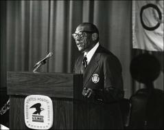 Thumbnail of Close up of Jesse Owens speaking at the Munich Olympics Postage Stamp presentation, 1972 (Horizontal shot)