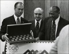 Thumbnail of Jesse Owens poses with other men for a photo, 1970s