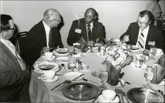 Thumbnail of Jesse Owens eats dinner at the Lincoln-Mercury Sports Panel event, 1973